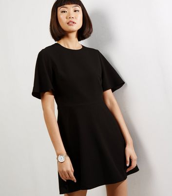Product photo of Black flutter sleeve skater dress