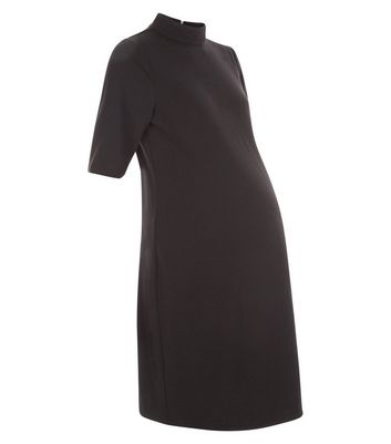 Product photo of Maternity black textured tunic dress