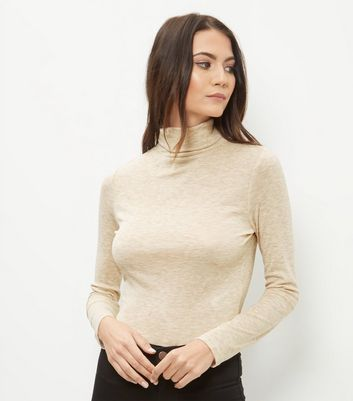 Product photo of Cream turtle neck cropped long sleeve top