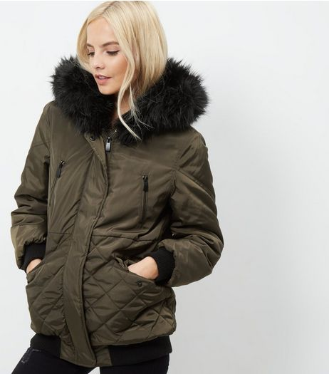 Petite Dark Green Faux Fur Trim Quilted Hooded Jacket  | New Look