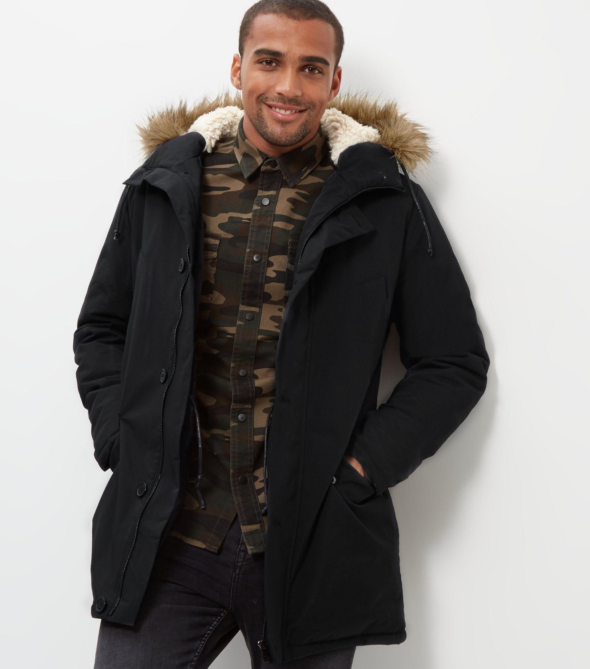 http://media.newlookassets.com/i/newlook/387762401/mens/jackets-and-coats/coats/black-faux-fur-trim-hooded-parka/?$new_pdp_szoom_image_2000$