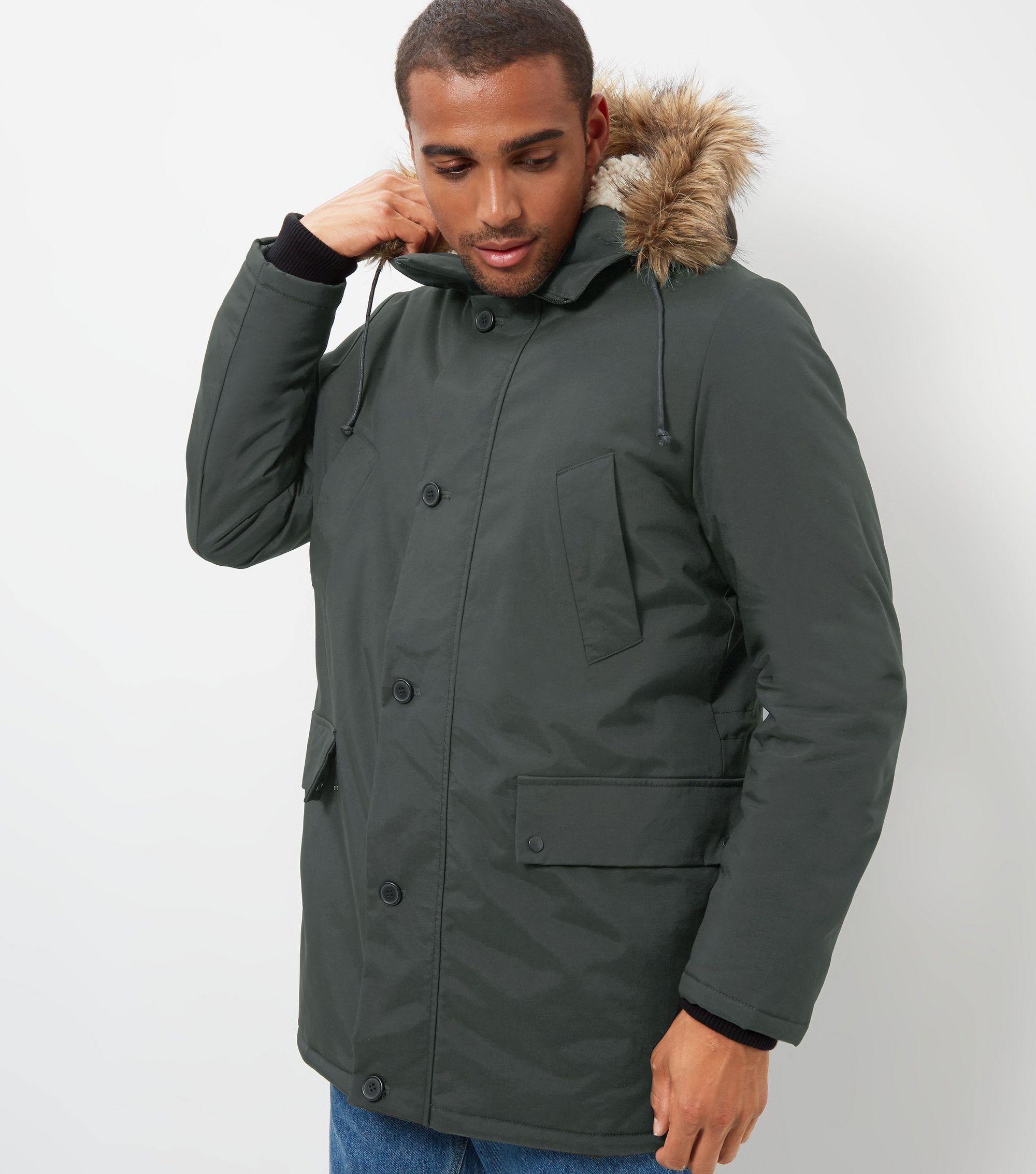 http://media.newlookassets.com/i/newlook/387762434/mens/jackets-and-coats/coats/khaki-faux-fur-trim-hooded-parka/?$new_pdp_szoom_image_2000$