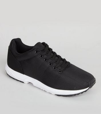 Product photo of Black lace up running trainers