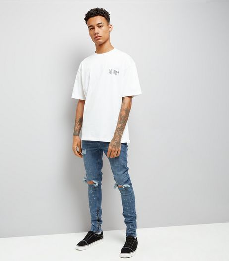 Blue Bleached Spray Ripped Knee Super Skinny Jeans  | New Look