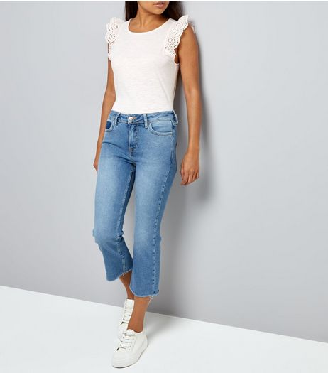 Petite Blue Cropped Raw Hem Flared Jeans | New Look