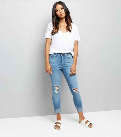 Petite Blue Ripped Knee Turn Up Relaxed Skinny Jeans | New Look